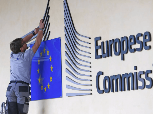 Workers adjust European Commission logo, Chris Brummer comments on circumstance