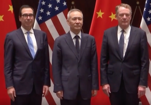 Image of three financial leaders standing in front of Chinese and American flags
